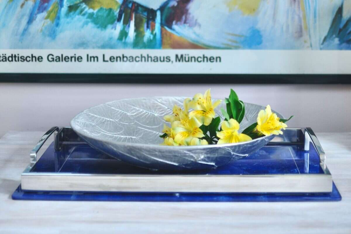lapis lazuli tray displaying silver bowl with flowers