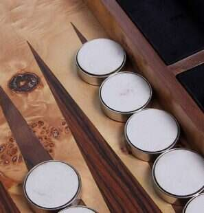 close up of backgammon pieces on a backgammon board