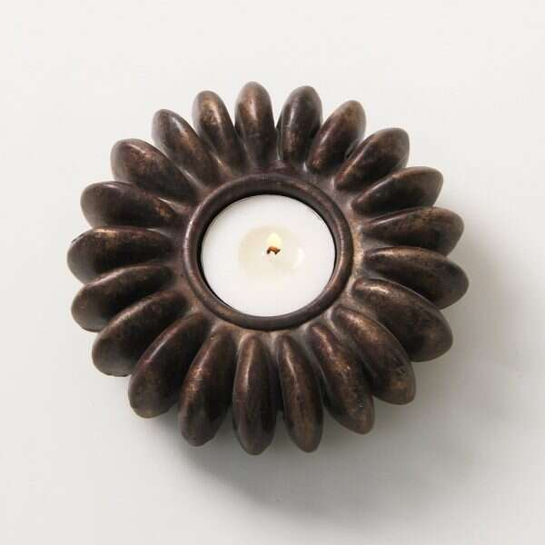 Sandbox Tree Seed tea light holders in antique bronze 1